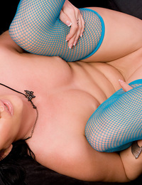 Taryn Thomas settles back into her black velvet lovechair and swings her neon blue stockinged legs into the air to expose her hot pussy!