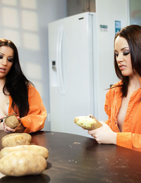 Inmates Daisy Cruz and Kristina Rose have had enough of KP duty and peeling potatoes, so these two sexy jailbirds peel off their own orange prison jum