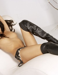 Lela Star will rock your world as she strips down to nothing but her knee-high leather boots and starts playing with her titties and pussy before jump