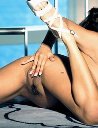 Seductive busty brunette Monica R