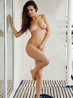Gillian B strips and showcases her gorgeous, large breasts, along with her smooth shaven labia in front of   the camera.