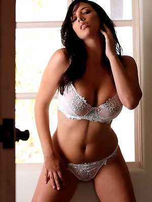 shows off her spicy curves in white lingerie